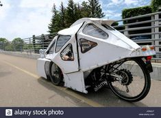 Download this stock image: Recumbent trike with prototype aerodynamic shell - JGN2J7 from Alamy's library of millions of high resolution stock photos, illustrations and vectors. Tricycle Bike, Strange Cars, E Mobility, Tail Light, Bicycles, Vectors, Camper, Shells, Gardening