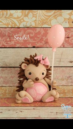 Cute hedge hog cake topper.