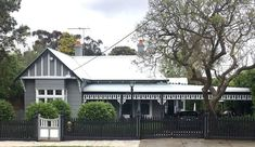 Dark grey Edwardian nearly black fence Grey Paint Colors, Paint Colors For Home, House Colors, Grey Fences, Black Fence, Weatherboard House, Queenslander, Grey Exterior, Exterior Colors