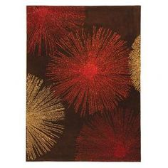 Hand-tufted wool rug in brown with a starburst motif. Made in India.   Product: RugConstruction Material: WoolColor: BeigeFeatures:  Made in  IndiaHand-tufted  Note: Please be aware that actual colors may vary from those shown on your screen. Accent rugs may also not show the entire pattern that the corresponding area rugs have.Cleaning and Care: Professional cleaning recommended