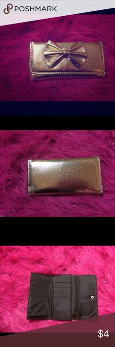 Gold bow wallet Super cute! Gold with a cute little bow. In great condition just a little scratches that you can see in pictures but hardly even noticeable. Has many slots and pockets. Was purchased from rue 21. Rue 21 Accessories