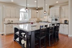 Chic French Kitchen Island with Marble Top and Black Wood Counter Height Bar Stools also White Distressed Kitchen Cabinets with Arch Raised Panel Cabinet Door from Kitchen Island Plans