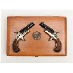 Boxed set of two Colt single shot derringers, cal. .22 short, Serial #73590D and 73591D. The pist