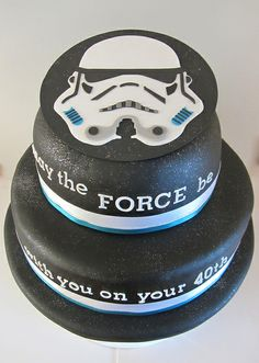 A 10 and 6 inch tiered design. The storm-trooper head is handmade from sugar paste and the regalice has silver glitter sprinkled in it to give the look of outer space.