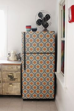 The Peel-and-Stick Makeover: Wallpapered Fridge. This is a gross pattern though. Something more simple would be mucho better.