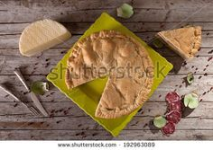 Overhead shot of traditionally italian savoury pie filled with cheese, salami and eggs and called pizza rustica.