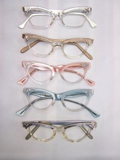 vintage cat eye glasses, My mom wore them, My first pair of glasses were shape like these, and they were brown.