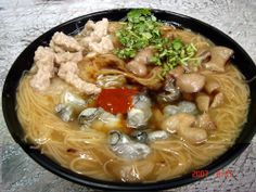 O-A-Mianxian (Oyster vermicelli) - Fresh oysters are added to red flour noodles and broth thickened with starch, then served with stewed sausage, black vinegar, and a special sauce and topped with cilantro.