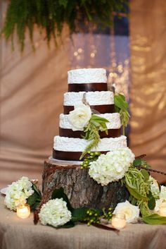 A tree trunk platform, brown accents and cream hydrangeas for a fall display!