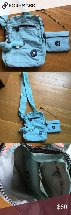 Kipling Cross Body Messenger Bag AND Wallet Kipling ice blue color cross body messenger bag with matching wallet. Both are in EXCELLENT condition. Bag has outside zippered compartment with a inside zippered compartment and a attachment for the matching wallet. Comes with the original monkey it was sold with. Bag is adjustable with a Velcro strap. Wallet has a billfold along with four slots for cards and a small change holder. Kipling Bags