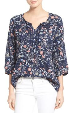 Adoring this lightweight and breezy top in a floral print that pairs perfectly with white denim and sandals for spring.