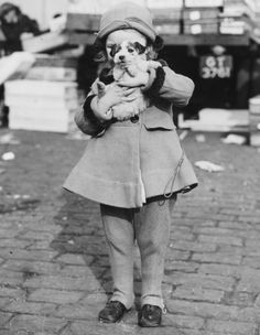 A girl and her dog, c. 1920s.