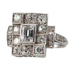 my breath is taken away...this is SO beautiful!!!  1930's Ring with Center Emerald Cut Diamond - Craig Evan Small