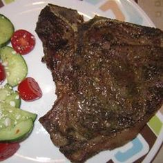 Greek-Seasoned T-Bone Steaks with Cucumber and Tomato Salad Allrecipes.com #ItsWhatsForDinner #leanbeef #beefgrilling