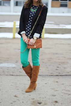 Love that color of green skinnies + the navy polka dot sweater.  Not a fan of the brown boots with the outfit, would do flats instead.