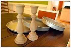 Candlesticks & cake pans to make a three tier stand