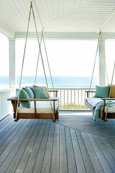 This is similar to the porch swing my father will build me next summer... needs chunky nautical rope though