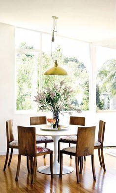 Tulip table, wood chairs, vintage Scandinavian pendant light