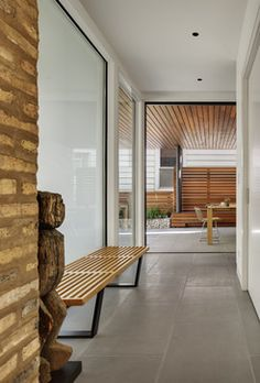 Love the mix of white walls, warm wood, and grey floors