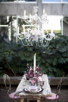 Are you looking to ask her to marry you? This is a beautiful table to provide the romantic setting you'll want. Rustic wooden table, elegant chandelier, shabby chic linens, and simple floral centerpiece. Outdoor Chandelier, Vintage Chandelier, Chandelier Ideas, Glass Chandelier, Pendant Lamps, Pendant Lights, Lustre Exterior, Cultura Judaica, Garden Wedding