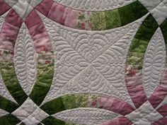 Quilting on a customer's double wedding ring quilt