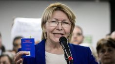 Attorney General Luisa Ortega Díaz addressing supporters on June 19, with the constitution in hand