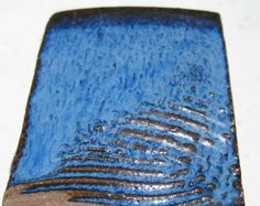 Example of Floating Blue Based on Mastering Cone 6 Glazes Glossy Base #1:  G-200 20% Frit 3134 20 Wollastonite 10 Epk 20 talc 11.5 flint 18.5 plus 1% cobalt 6% rutile .5 Iron Ox
