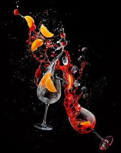 Still life studio hi-speed explosive photography of a coctail in midair.