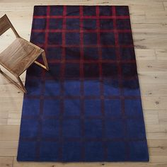 Shop nevrmind rug.   A familiar plaid with a rock-and-roll twist.  We're bringing a little 90s nostalgia home in this blue and red hand-tufted rug dip-dyed purple to a little more than center.