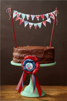 County Fair Cake from Cakewalk. Love the ribbon and the bunting!