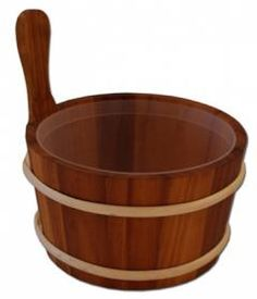 This traditional sauna bucket is made of heat treated wood. The heat treatment gives the wood a beautiful dark color. The bucket has a plastic insert. Plastic inserts protect the wooden surface and helps keep sauna bucket clean. The bucket has been treated with oil.