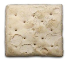 """Civil War Hardtack This cracker was a Union soldier's main ration. Popularly known as """"sheet iron crackers,"""" they were notoriously difficult to bite into and chew. Unlike leavened bread, hardtack was quite durable and would keep for a veeeerrrry long time. This cracker was signed by two soldiers of the Eighth Pennsylvania Infantry and kept as a souvenir of their service."""