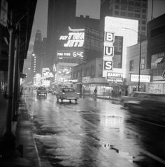 themanonfive:  Randolph Street looking west at night, Chicago. Undated.