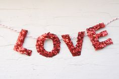 In large letters, covered in red glitter...different arrangement maybe? It has potential :)