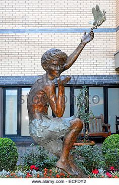 Peter Pan statue in small garden outside Great Ormond Street hospital for Children - Stock Image