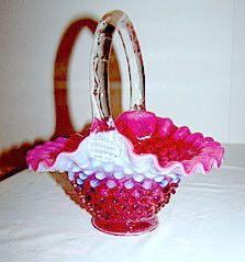 Here is a very pretty Fenton hobnail basket in the cranberry opalescent color. It stands 8 inches tall and is 7 inches wide. This basket is in very nice condition with no chips or cracks and it is mar