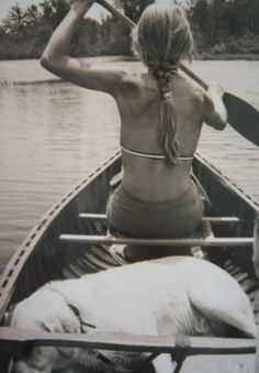 canoeing, this picture looks like my daughter Cheyenne & our dog Cinnamon canoing down the Russian River.