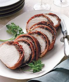 Bacon-Wrapped Pork Loin With Cherries | Get the recipe: http://www.realsimple.com/food-recipes/browse-all-recipes/bacon-wrapped-pork-loin-cherries-00000000008996/index.html