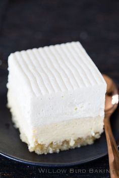 Vanilla Bean Cheesecake Bars - this delicious, decadent dessert consists of a buttery macadamia nut crust, a creamy layer of vanilla bean cheesecake, a tangy vanilla bean sour cream topping, and finally a cloud of vanilla bean whipped cream mousse. In short, it's a vanilla lover's dream!