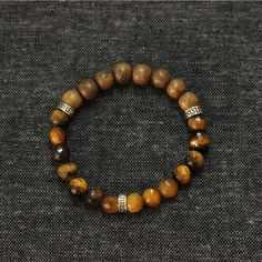 #modern #men need #accessories Tiger Eye & Wood ... just added -> http://mistermodern.com/products/tiger-eye-wood-bracelet?utm_campaign=social_autopilot&utm_source=pin&utm_medium=pin