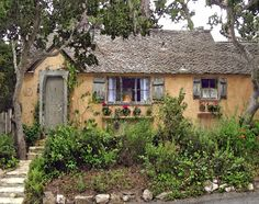 I would NEVER leave the house if I lived here. I will add it to my To Purchase List for when I win the lottery!    http://talesfromcarmel.com/2011/09/14/sunwise-turn-a-hugh-comstock-fairytale-cottage-in-carmel-by-the-sea/