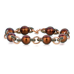 Chocolate pearls with chocolate diamonds in strawberry gold how  divine.  Marshall Jewelry