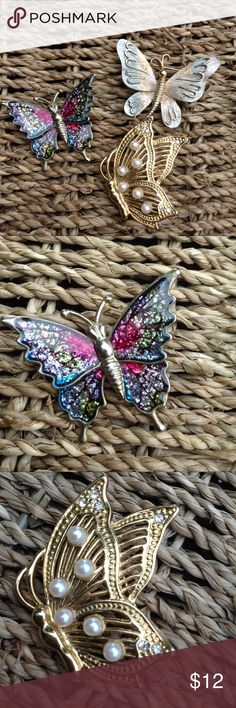 Pair of Vintage Butterfly Pins Brooches This is for two with the third thrown in for free.  Gorgeous rainbow sparkle pin with goldtone setting.  Not sure how old it is, but the closure is unique.  Second is goldtone profile view butterfly pin with rhinestones and faux pearls.  Third is free due to chip, but it's too beautiful to throw out. Accessories