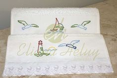 Hand towels embroidered with nautical motifs.