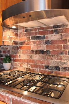 Brick backsplash. green idea: diy kitchen backsplashes | refresheddesigns.sustainable design