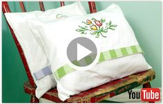 Free video with instructions on how to embroider tea towel pillows.