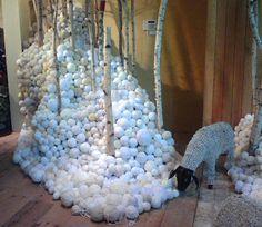 Anthropologie display....but instead of balls of yarn, styro balls that look like snow....