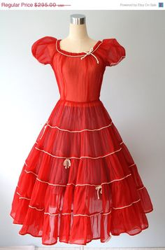 Stunning Sheer 1950s cocktail gown.  Sans underpinnings, for reasons which are unclear.