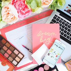 Desk flat lay with lots of pink and pretty stationary