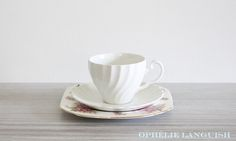 Elegant tea cup and saucer in the Snowhite Regency swirl style. White side/dessert/snack plate features beautiful pink peach blossoms and gold trim. Very shabby chic! Tea Cup Saucer, Tea Cups, Johnson Brothers, Peach Blossoms, China Patterns, Cottage Chic, How To Run Longer, Regency, Tea Party